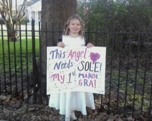 After she worked so hard on her sign, I didn't have the heart to tell her it was GRAS. This was her first Mardi Gras, at her first parade ever: Muses.